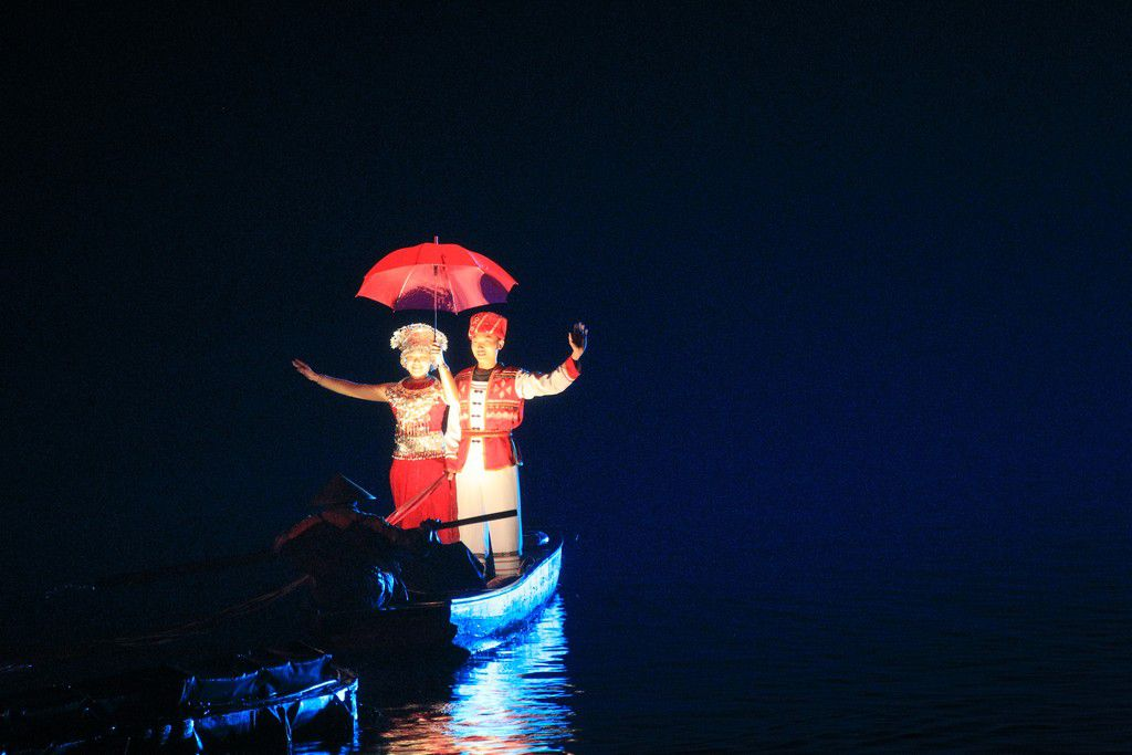 Liusanjie Show Three Humans in Boat